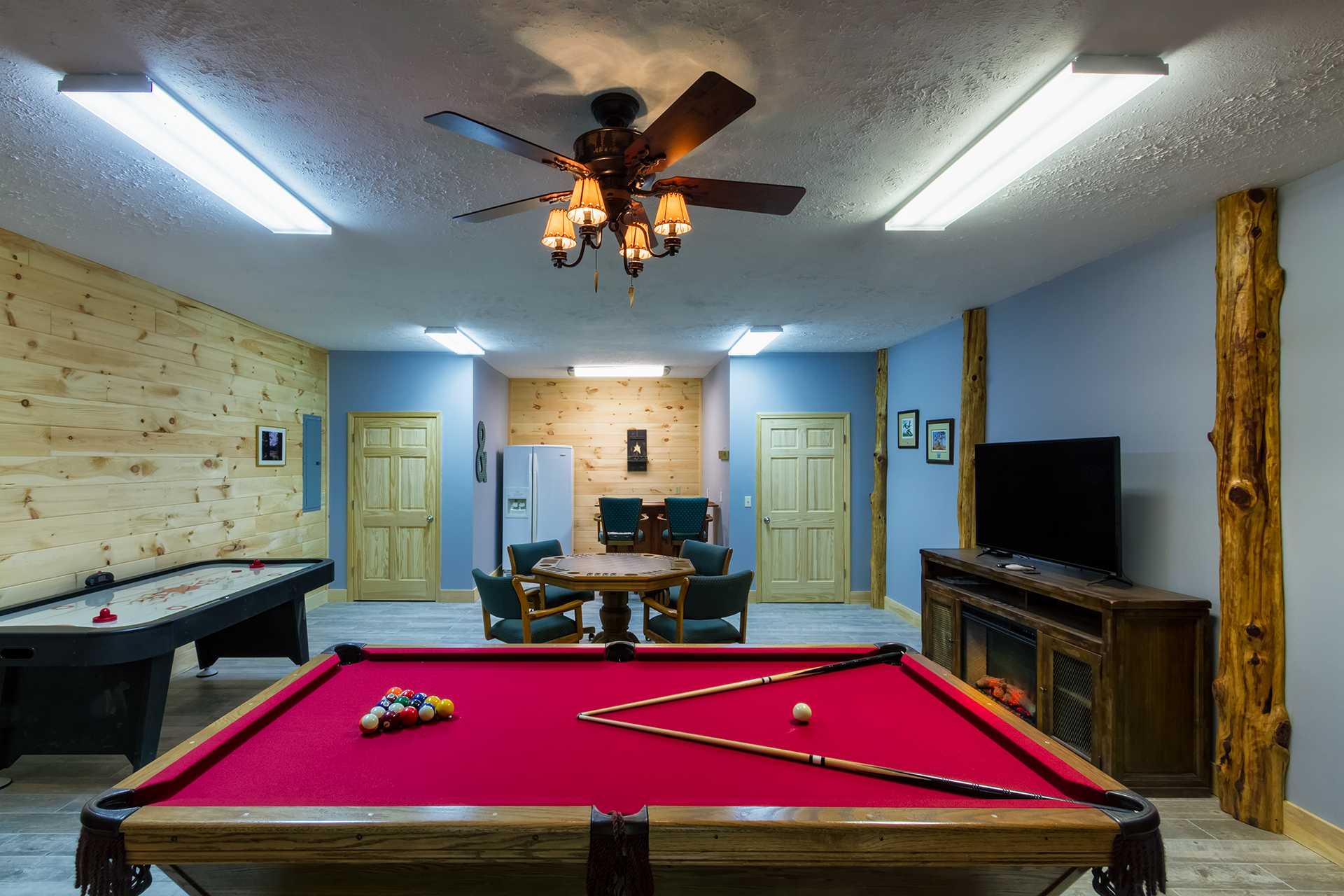the game room on the lower level where you can play a game of billiards on the regulation size pool table or challenge someone to a game of air hockey